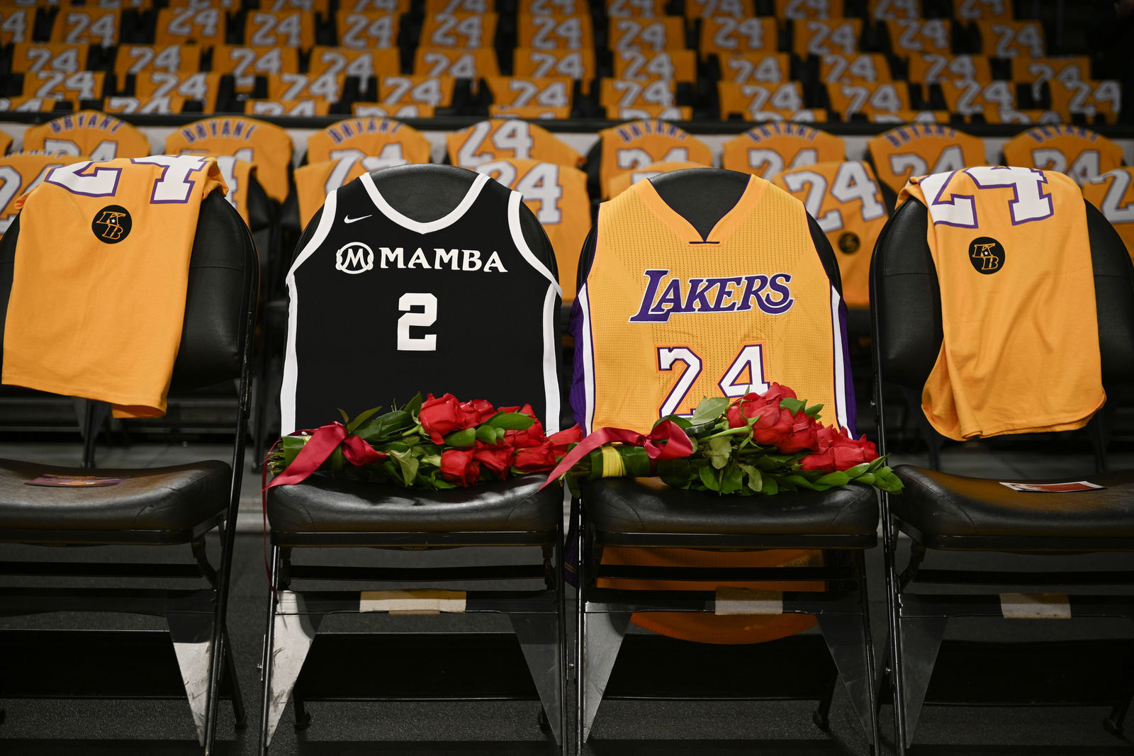 FILE - In this Jan. 31, 2020, file photo, the jerseys of late Los Angeles Laker Kobe Bryant, right, and his daughter Gianna are draped on the seats the two last sat on at Staples Center, prior to the Lakers' NBA basketball game against the Portland Trail Blazers in Los Angeles.{ } (AP Photo/Kelvin Kuo, File)
