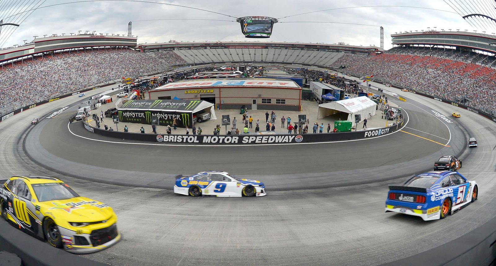 Drivers race through Turns 1 and 2 early in the NASCAR Cup Series auto race at Bristol Motor Speedway on Sunday, April 7, 2019, in Bristol, Tenn. (David Crigger/Bristol Herald Courier via AP)