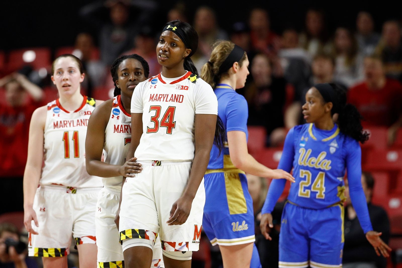 Maryland forward Brianna Fraser (34) reacts alongside teammates Taylor Mikesell (11) and Channise Lewis after being called for a foul during the second half of a second-round game against UCLA in the NCAA women's college basketball tournament, Monday, March 25, 2019, in College Park, Md. UCLA won 85-80. (AP Photo/Patrick Semansky)