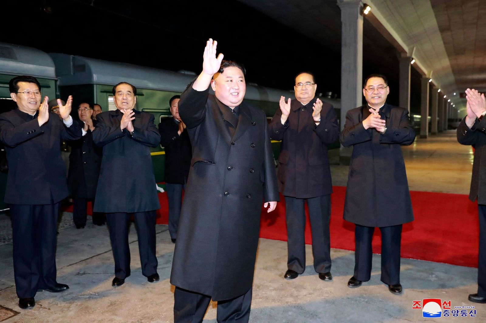 In this photo provided by the North Korean government, North Korean leader Kim Jong Un waves at an undisclosed train station in North Korea Wednesday, April 24, 2019, before leaving for Russia.{ } (Korean Central News Agency/Korea News Service via AP)