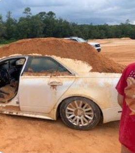 REPORT: Crestview man arrest for criminal mischief after dumping heaps of dirt on car. (Source: Okaloosa County Sheriff's Office/ Photo: picture of 2010 Cadillac)