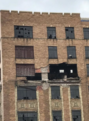 Saginaw Police are advising people to stay away from the Genesee Street Bridge because debris is falling from a crumbling building. (Photo Credit:  Zach Mersdorf)