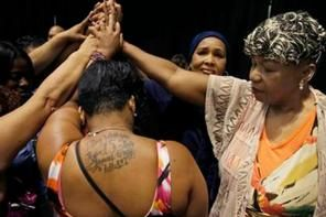 Gwen Carr, mother of Eric Garner, right, joins women whose families members were killed by police officers. (Photo: AP)