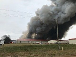 Multiple fire departments converge Friday, Jan. 3, 2020, on a fire at a poultry farm in Otsego, Michigan. (WWMT/Sara White)