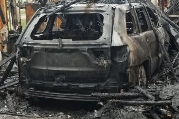 This is what remains of a 2018 Jeep Cherokee that burned up in the family's garage during the Sunday night fire. (Courtesy photo)