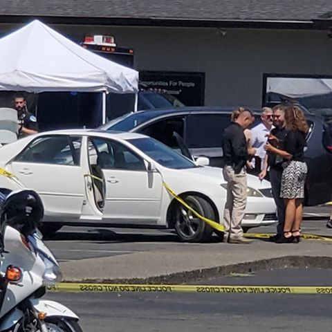 Pictured is the scene at the Oregon State Police offices in Grants Pass, taped off with police tape. (Courtesy Marcus Hartley)