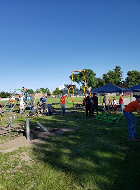 Over 90 people came out to Hacker Middle School in Mountain Home, Saturday morning, to help build the school's first playground. Volunteers also repainted lineson the school's basketball courts, created a yoga space, and gave theplayground a new hacker Middle School logo. (Courtney Lewis and Kim Wortham)