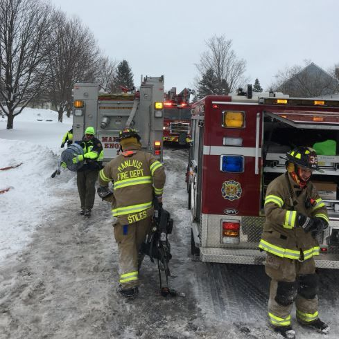 Crews battle house fire in winter conditions