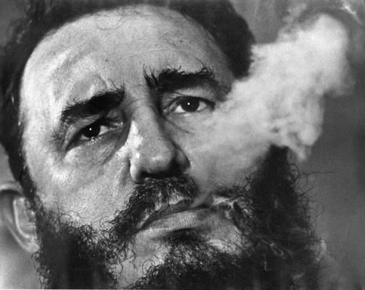 In this March 1985 file photo, Cuba's leader Fidel Castro exhales cigar smoke during an interview at the presidential palace in Havana, Cuba. Castro has died at age 90. President Raul Castro said on state television that his older brother died late Friday. AP photo / Charles Tasnadi