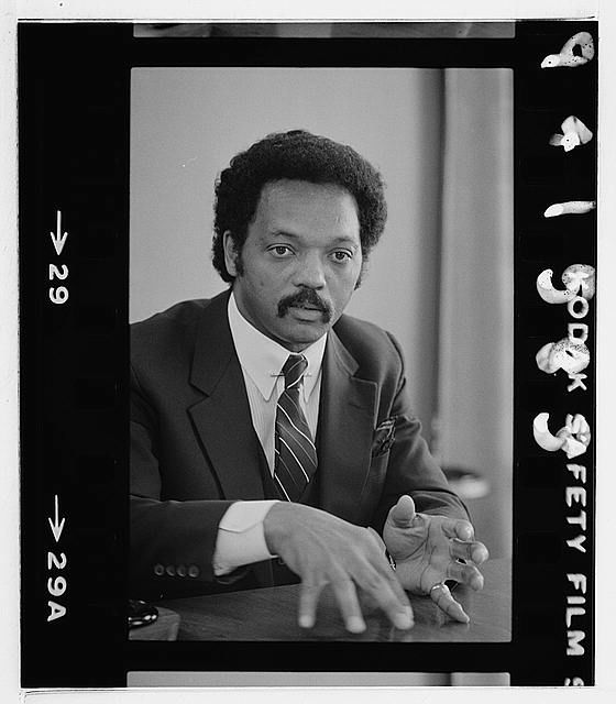 Photograph shows half-length portrait of Jackson seated at a table in July 1982. Courtesy: Library of Congress{ }