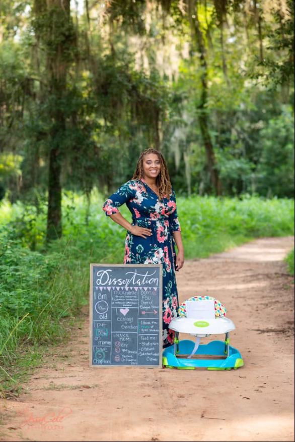 Woman poses with dissertation in hilarious maternity photo shoot (Photos given to WPEC thanks to Korie Mitchell JessaCole Photography)