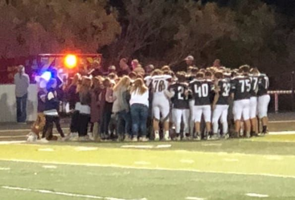 Hawley and Forsan players gather to pray for player's grandmother who suffered a heart attack in the stands (Courtesy: Rebecca Medina)<p></p>
