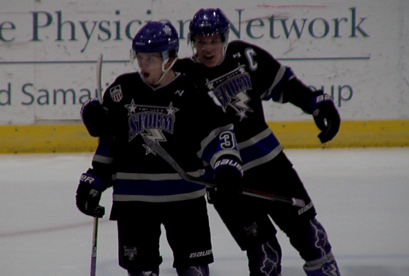 Zac Jones (left) celebrates after scoring a goal for the Tri-City Storm as Ronnie Attard joins him. (KHGI)