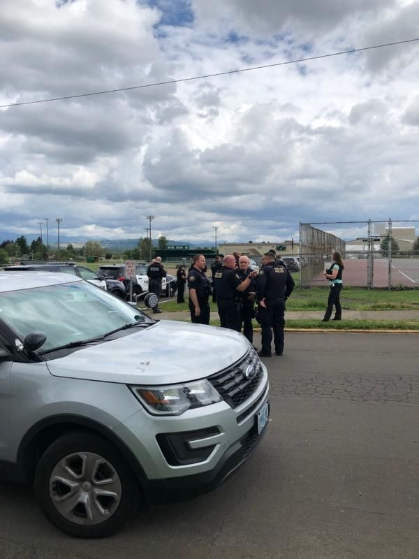 Police respond to Parkrose High School on May 17, 2019 for a report of a person armed with a gun. They say a school staff member wrestled the suspect to the ground before police arrived. The suspect is in custody. Photo courtesy Hugo Anguiano
