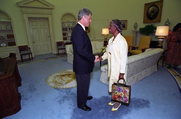 President William J. Clinton Greeting Shirley Chisholm, Ambassador-Designate to Jamaica July 7, 1993. Courtesy: National Archives{ }