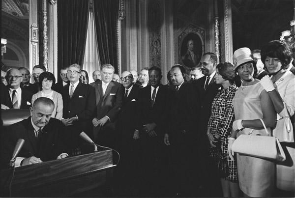 President Lyndon Johnson Signs the Voting Rights Act as Martin Luther King, Jr., with Other Civil Rights Leaders in the Capitol Rotunda, Washington, DC, 08/06/1965 Courtesy: National Archives{ }