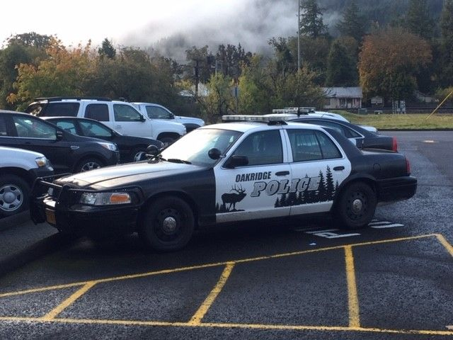 Authorities investigate following an officer-involved shooting in Oakridge, Ore., on Oct. 17, 2019. Photo of police vehicles in the Oakridge PD parking lot on Oct. 18, 2019. (SBG)