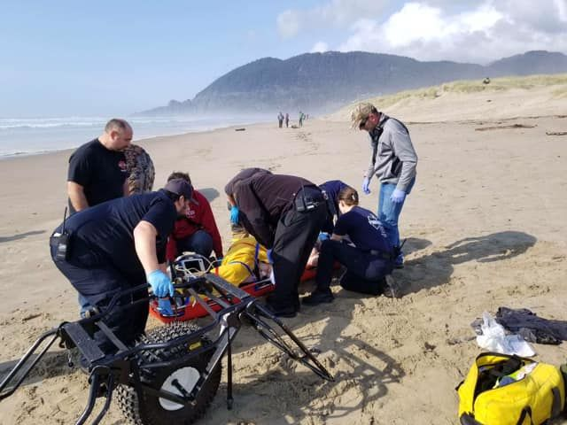 Woman hurt by rolling log - Nehalem Bay Fire and Rescue photo