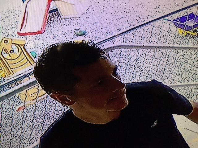 School's donation jar stolen, police searching for suspect. (Photo DeWitt Police).