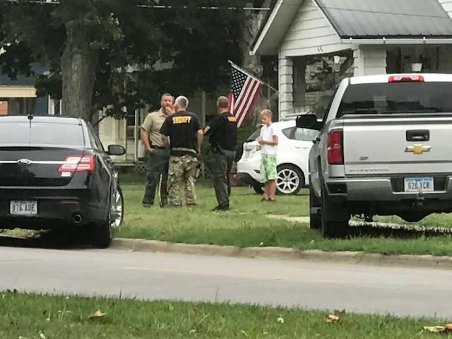 Ottumwa officers and Wapello County deputies search a residence behind McDonald's in Ottumwa around 7 a.m. Thursday/KTVO<p></p><p></p>