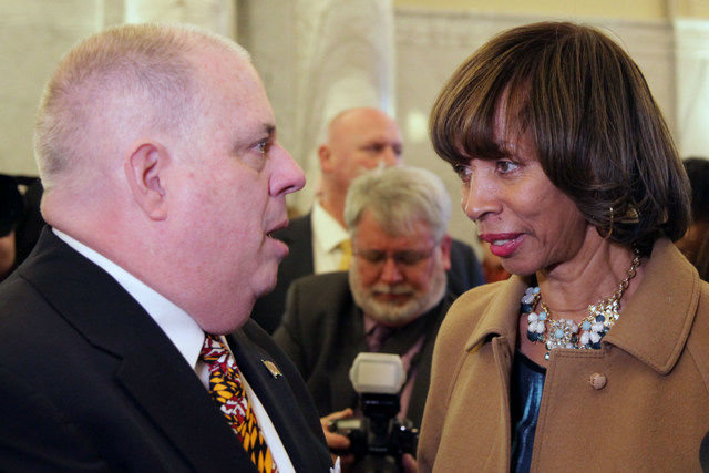 FILE - Governor Larry Hogan, a Republican, and Baltimore City Mayor Catherine Pugh talk before the opening session of the Maryland legislature on Wednesday, Jan. 11, 2017, in Annapolis, Md. (Hannah Klarner/Capital News Service via AP)