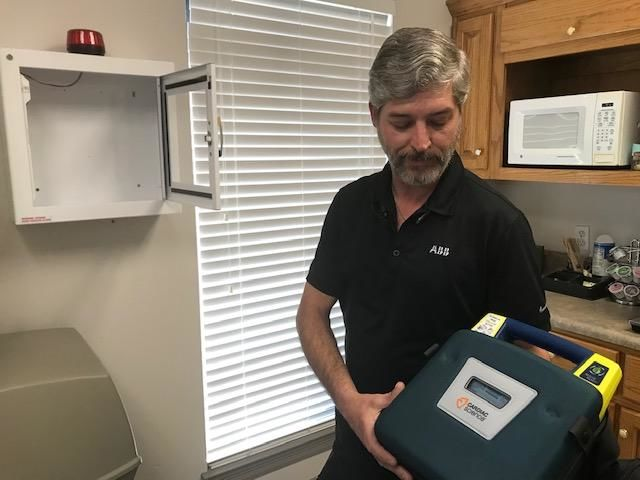 (IMG: WPMI) Employees use AED to save coworker's life