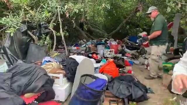 Reporter Stephanie Rothman saw bikes, bedding, rotting food and dozens of dirty needles at an abandoned camp on an island in the Willamette River as city crews cleaned up the site Tuesday. (SBG)<p></p>Thumbnail