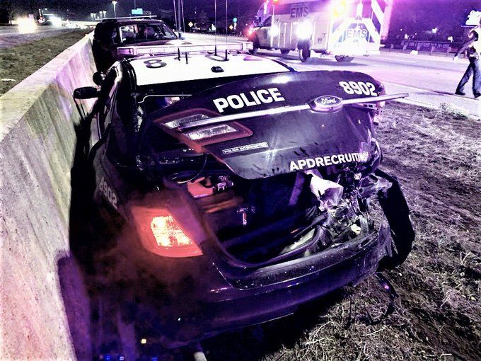 The crash ended with a mangled patrol car. The officer inside says she was working an unrelated wreck on I-35 south of Slaughter Lane. (Photo courtesy: Austin Police Department)