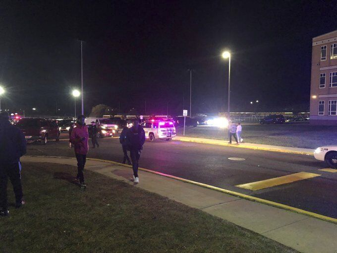 Game attendees leave after shots rang out Friday, Nov. 15, 2019, at a Pleasantville-Camden high school football playoff game in Pleasantville, NJ. Pleasantville Police Captain Matt Hartman says someone opened fire at Pleasantville High School on Friday night during a home game against Camden High School. The Press of Atlantic City reports at least two people were wounded when a shooter fired a gun about a half dozen times in the stands filled with spectators.(Ahmad Austin/The Press of Atlantic City via AP)