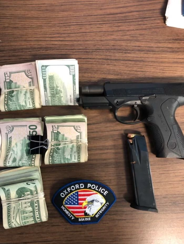 A .40-caliber gun with a loaded magazine, and $3,688 in cash were seized from a Norway man found passed out in the lobby of the Hampton Inn in Oxford on Friday. (Oxford Police Department)