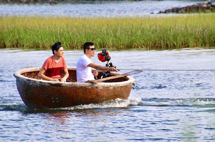 Two men make bowl-boat complete with weed eater motor in Pensacola. Source - Jennifer Vicente