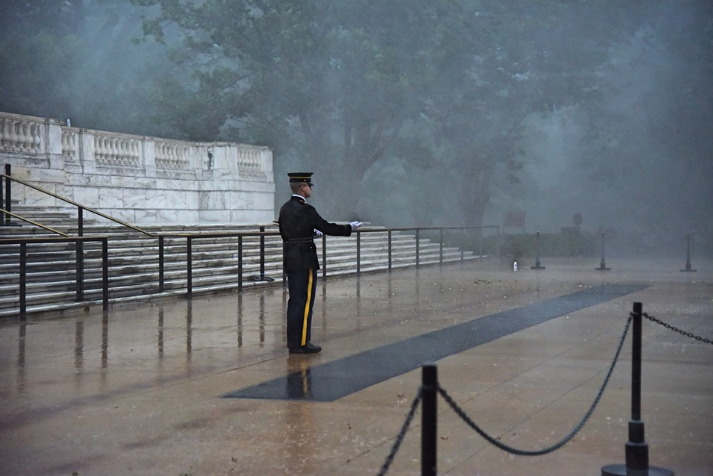 A Soldier of the 3d U.S. Infantry Regiment (The Old Guard) plants a U.S. flag in front of the Tomb of the Unknown Soldier during a severe storm for Flags In at Arlington National Cemetery, May 23, 2019.{ } (U.S. Army photo by Sgt. Maryam Treece)