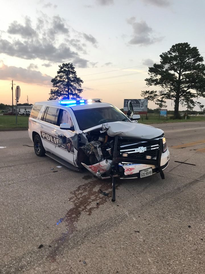 A photo from the Crockett (Texas) Police Department shows car damage after a suspect tried to plow through a police barricade on Aug. 21, 2019.