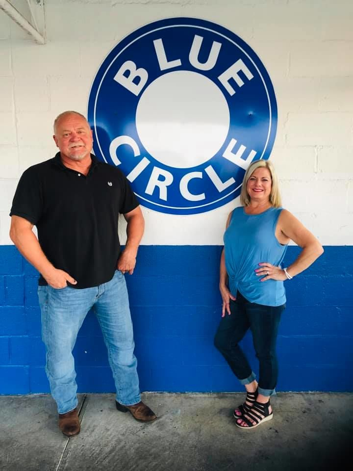 Mark and Debbie Sourbeer standing in front of the iconic Blue Circle (Photo Credit: Debbie Sourbeer)