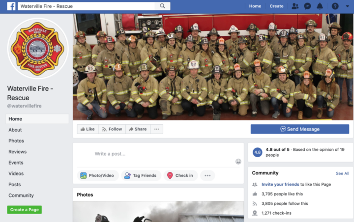 A Waterville fire department photo where a firefighter can be seen making a hand gesture associated with white power. (Screenshot of Waterville Fire Rescue | BDN)