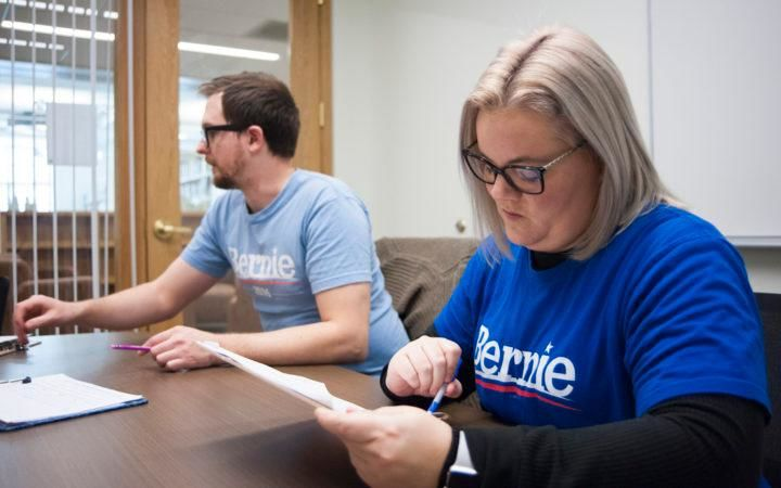 Megan Smith of Milford, right, and Seth Braun of Bangor go over materials before canvassing for Bernie Sanders on Saturday afternoon. (Natalie Williams | BDN)