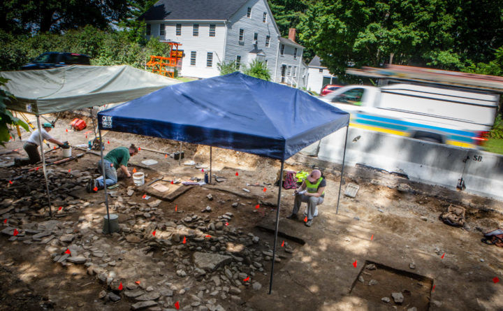A team of Maine Historic Preservation Commission archaeologists dig under one side of the River Road in Windham last week, searching for a colonial-era fort. The team of diggers has an eight-week window to look before upcoming road work levels the site. Troy R. Bennett | BDN