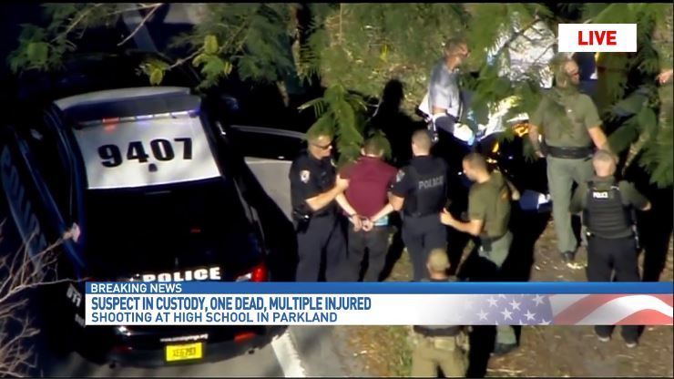 The suspect in a shooting at a high school in Parkland, Florida, is taken into custody. (CNN Newsource)<p></p>