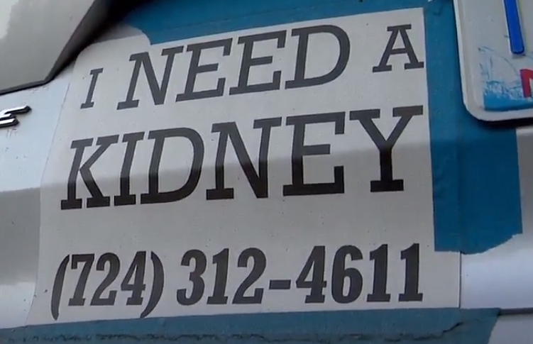 "Spencer Duin and his wife Carol have been driving around Asheville with ""I need a kidney"" signs taped to the back of their cars for about 15 months. Photo credit: WLOS staff"