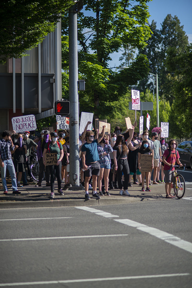 Protesters at today's march wait peacefully for the crosswalk to signal that it is safe to cross on their march from the Lane County Circuit Court to the Lane County Jail. Photo by Abby Libbert