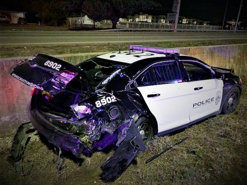 Court documents said that as she sat in her car with the emergency lights on, she noticed headlights fast-approaching her. She jumped out of the car to safety -- just 3 seconds before impact. (Photo courtesy: Austin Police Department)