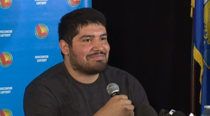 Manuel Franco of West Allis comes forward to claim his $768 million Powerball jackpot prize, April 23, 2019. (WITI-TV)