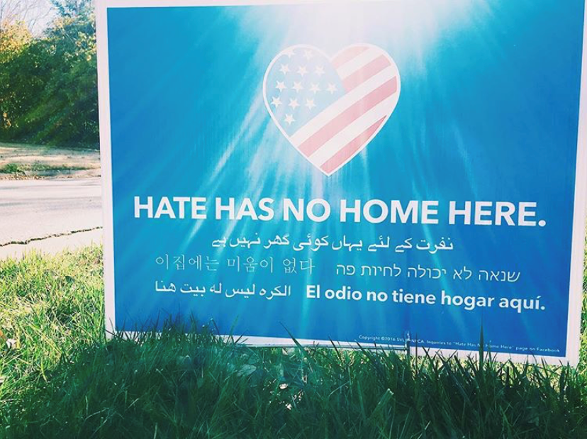 "Yard signs and bumper stickers read ""Hate has no home here."" (Caroline Vandergriff/KOKH)"