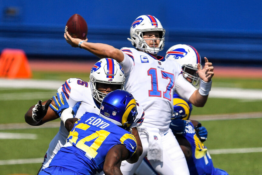 Buffalo Bills quarterback Josh Allen (17) throws a pass during the first half of an NFL football game against the Los Angeles Rams Sunday, Aug. 26, 2018, in Orchard Park, N.Y. (AP Photo/Adrian Kraus)