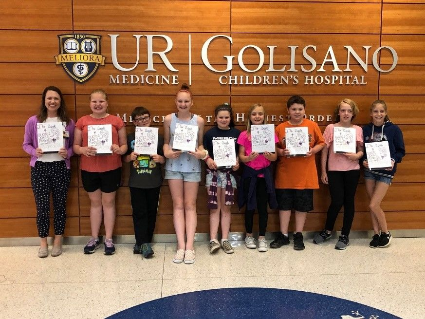 Students brought 25 copies of their book to Golisano Children's Hospital where their book will be available for check out for all families and patients. (Photo: Webster CSD)