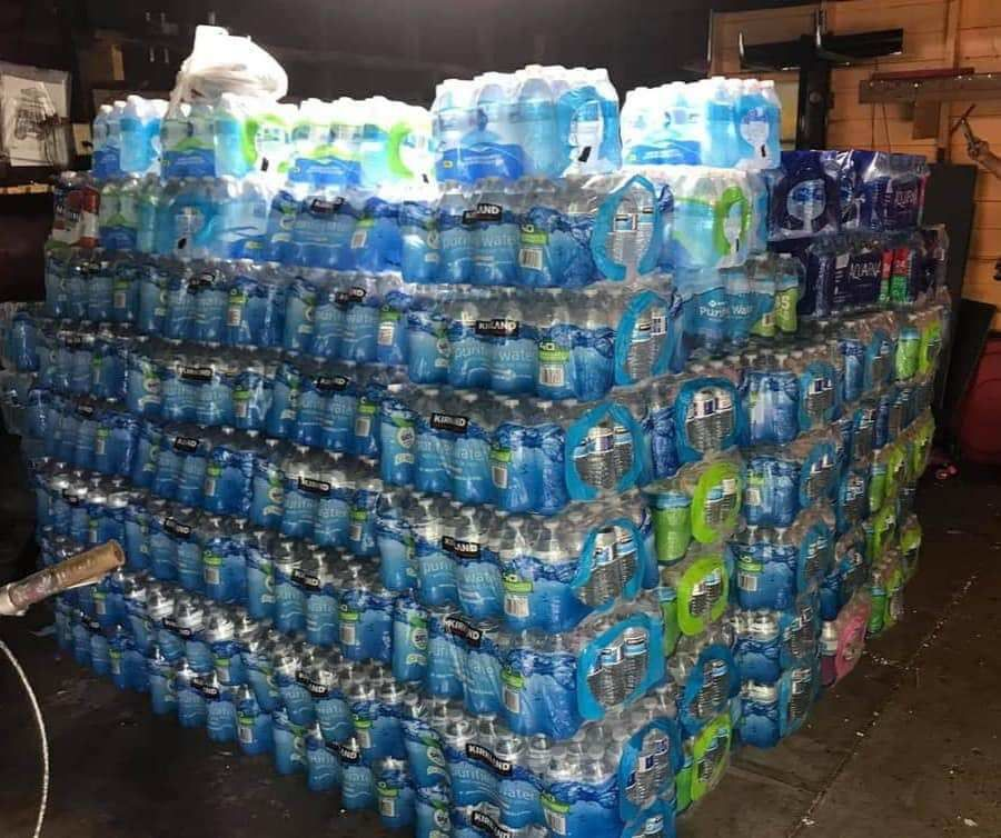 Water was stacked so high July, 23, 2020, that, several of the cases started to fall. The hope is to load several trucks, and send them on their way to Flint.{ }(WWMT/Courtesy Tamara Custard)