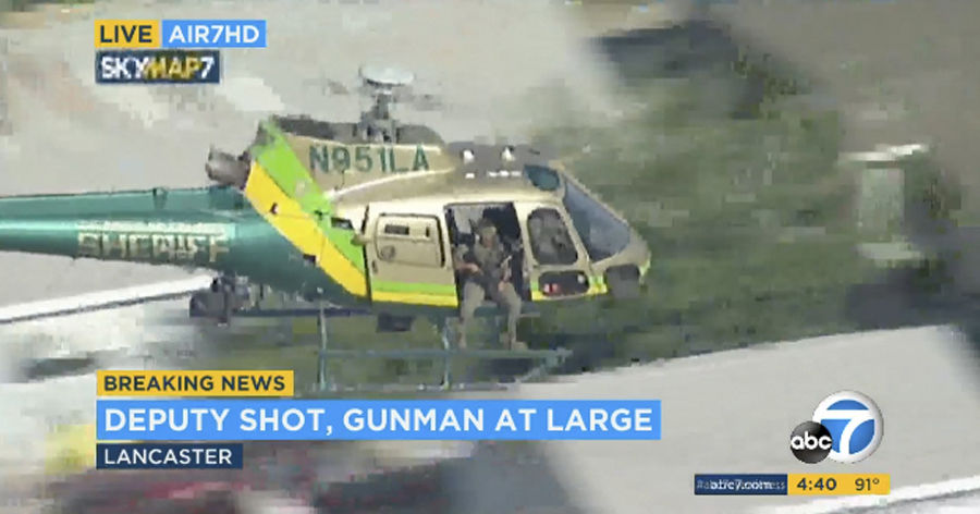 "FILE - This Wednesday, Aug. 21, 2019 file image taken from video provided by KABC-TV shows a sheriff's department helicopter with a sniper in an open door searching for a gunman at large in Lancaster, Calif. The Los Angeles County Sheriff's Department says a deputy who claimed he was shot in a station parking lot earlier this week was lying. Assistant Sheriff Robin Limon said at a news conference late Saturday that Wednesday's ""reported sniper assault was fabricated"" by Angel Reinosa. The 21-year-old deputy told authorities he used a knife to damage his uniform shirt. He's been relieved of duties and will face a criminal investigation. He didn't explain his motive. (KABC-TV via AP, File)"