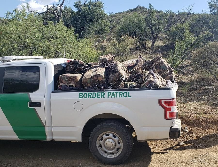 U.S. Border Patrol agents said they seized over 820 pounds of marijuana and arrested 11 illegal aliens in a remote, mountainous canyon in southern Arizona. (Source: CBP)