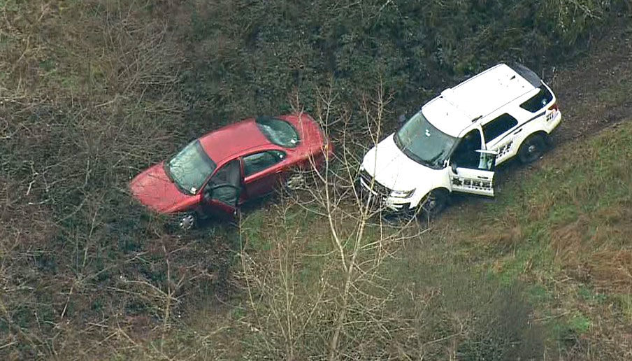 The stolen red Taurus was found abandoned along{ } 86th Avenue. (KOMO News photo)