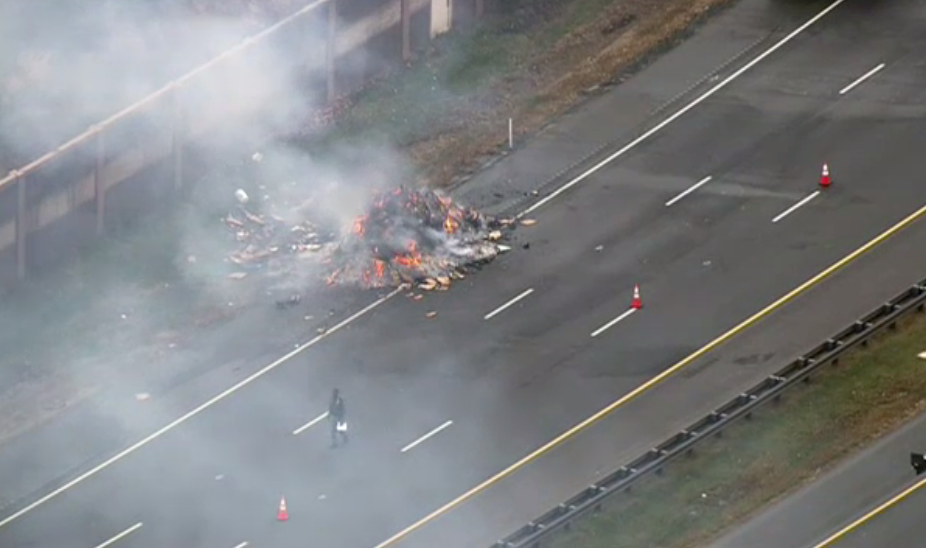 A pile of trash burns on the ICC. (Photo: ABC7)